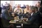 President George W. Bush and Sen. Chuck Grassley, R-Iowa, participate in an interview with radio talk show host Jan Mickelson at the Spring House Family Restaurant in Cedar Rapids, Iowa, March 30, 2005. White House photo by Paul Morse