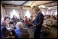 President George W. Bush talks with senior citizens at the Spring House Family Restaurant in Cedar Rapids, Iowa, March 30, 2005. White House photo by Paul Morse