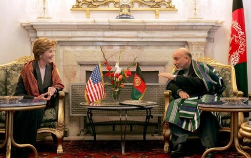 Afghan President Hamid Karzai jokes with Laura Bush during a meeting in the Presidential Palace in Kabul, Afghanistan Wednesday, March 30, 2005. White House photo by Susan Sterner