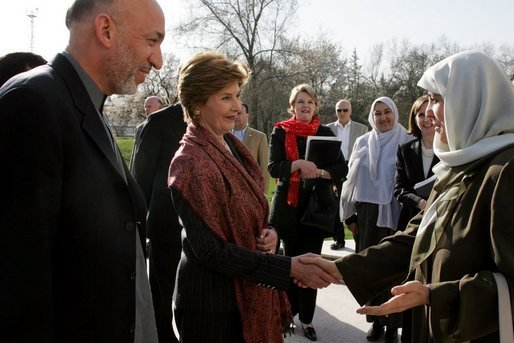 First lady Laura Bush and Margaret Spellings, Secretary of Education, center, stand with Afghan President Hamid Karzai Wednesday, March 30, 2005, after their arrival in Kabul. White House photo by Susan Sterner