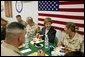 Laura Bush laughs with troops as they eat dinner in the Dragon Chow Dining Hall on Bagram Air Base in Kabul, Afghanistan Wednesday, March 30, 2005. White House photo by Susan Sterner
