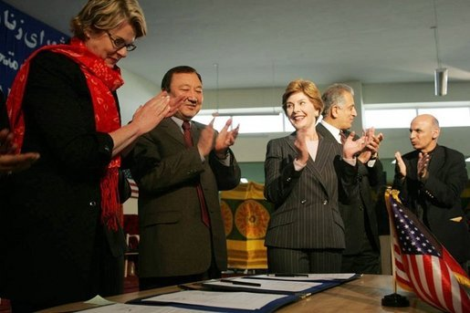 Laura Bush applauds as Secretary of Education Margaret Spellings and Afghan Minister of Education Noor Mohammas Qarqeen complete the signing of the Memorandum of Understanding for funds to build a university in Kabul, Afghanistan Wednesday, March 30, 2005. White House photo by Susan Sterner