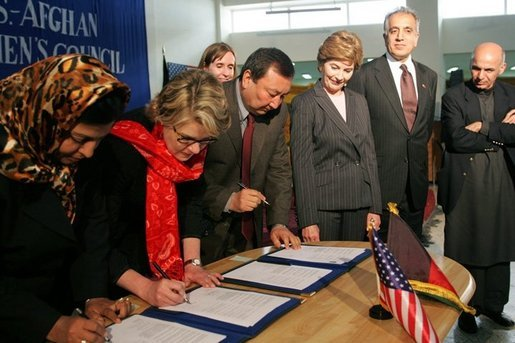 Laura Bush observes as Secretary of Education Margaret Spellings and Afghan Minister of Education Noor Mohammas Qarqeen complete the signing of the Memorandum of Understanding for funds to build a university in Kabul, Afghanistan Wednesday, March 30, 2005. White House photo by Susan Sterner