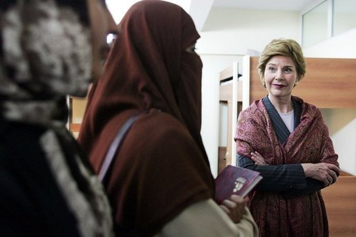 Laura Bush talks with female students in the newly built National Women's Dormitory on the campus of Kabul University Wednesday, March 30, 2005, in Kabul, Afghanistan. The women's dormitory was built to provide a safe place for young women to live while pursuing studies away from their families. White House photo by Susan Sterner
