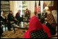 Laura Bush and Dr. Zenat Karzai, wife of President Hamid Karzai, center, join Paula Dobrianski, second from left, Under Secretary of State for Global Affairs, and Margaret Spellings, U.S. Secretary of Education, third from left, as they talk with Afghan women about issues of women's rights and education at the presidential residence in Kabul Wednesday, March 30, 2005. White House photo by Susan Sterner