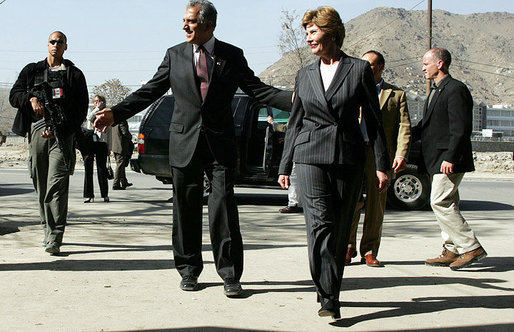 Laura Bush and U.S. Ambassador to Afghanistan Zalmay Khalilzad walk to a bakery in Kabul, Afghanistan Wednesday, March 30, 2005. White House photo by Susan Sterner
