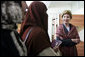 Laura Bush talks with female students in the newly built National Women's Dormitory on the campus of Kabul University Wednesday, March 30, 2005, in Kabul, Afghanistan. The women's dormitory was built to provide a safe place for young women to live while pursuing studies away from their families.White House photo by Susan Sterner