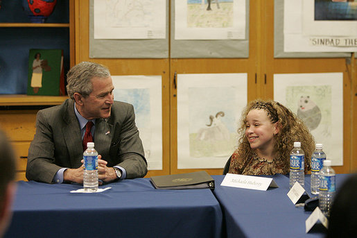 President Bush and 10-year-old Michaela Huberty exchange thoughts during a roundtable discussion Friday, April 1, 2005, at Paul Public Charter School in Washington DC. Michaela, a fourth-grader at Benjamin Mays Magnet School in St. Paul, Minn., is being raised by her mother while her father is in prison. As part of the President's Helping America's Youth initiative, Michaela joined the Kinship program in her hometown and gained a mentor, adding another positive adult in her life. White House photo by Eric Draper