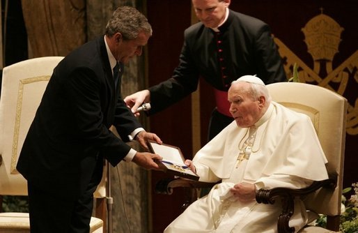 The President presents the Medal of Freedom to Pope John Paul II during a visit to the Vatican in Rome, Italy in June 2004. White House photo by Eric Draper