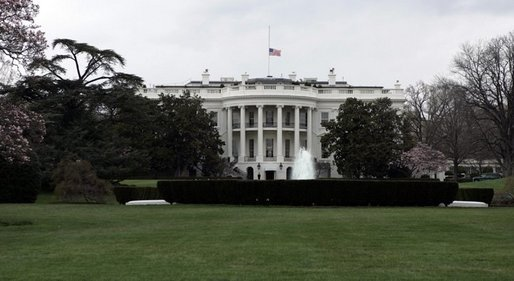 The American flag flies at half-staff Sunday after President George W. Bush ordered flags lowered as a sign of respect for the late Pope John Paul II, who died Saturday in Rome. White House photo by Paul Morse