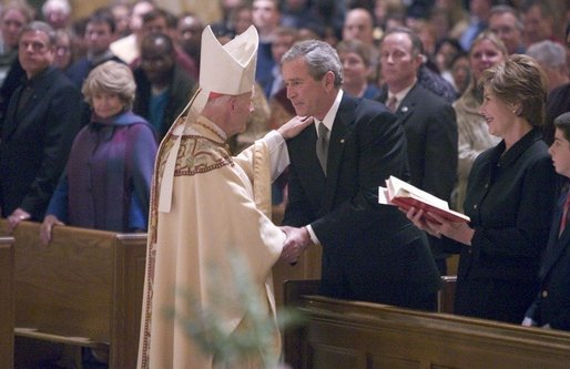 Cardinal Theodore McCarrick greets President George W. Bush and Mrs. Laura Bush after mass at the Cathedral of Saint Matthew the Apostle in Washington, DC on Saturday, April 2, 2005 in remembrance of Pope John Paul II. White House photo by Paul Morse