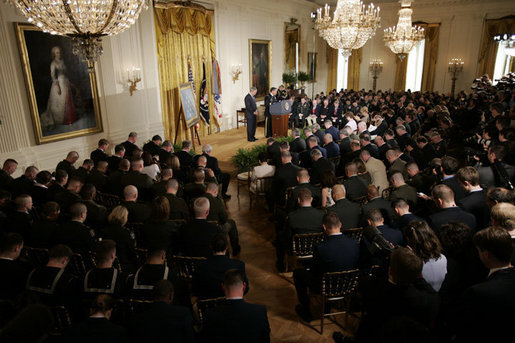 The audience bows its head as Major General David Hicks, standing at the podium, gives the invocation Monday, April 4, 2005, during the posthumous Medal of Honor ceremony for Sgt. 1st Class Paul Smith at the White House.White House photo by Paul Morse