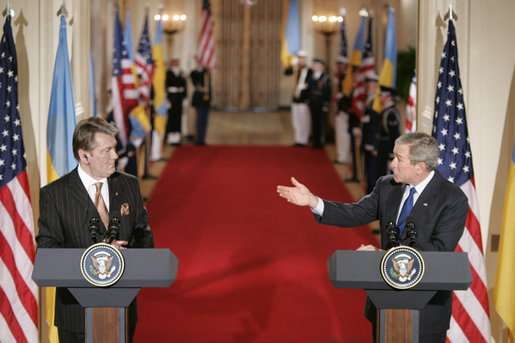 President George W. Bush gestures to Ukraine President Viktor Yushchenko Monday, April 4, 2005, during a press availability at the White House.White House photo by Paul Morse
