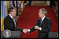 President Bush and President Yushchenko shake hands after a press availability Monday, April 4, 2005. The Ukraine president and his wife visited the White House for the day.White House photo by Paul Morse