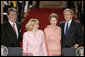 President George W. Bush and Ukraine President Viktor Yushchenko are joined at the podiums by first ladies Laura Bush and Kateryna Yushchenko Monday, April 4, 2005, in the East Room of the White House.White House photo by Paul Morse