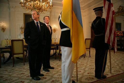 President George W. Bush and Ukraine President Viktor Yushchenko wait for the start of a press availability during Mr. Yushchenko's visit Monday, April 4, 2005, to the White House.White House photo by Eric Draper