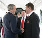 President George W. Bush and Ukraine President Viktor Yushchenko shake hands upon Mr. Yushchenko's departure Monday, April 4, 2005, following his visit to the White House.White House photo by Eric Draper