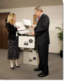 President George W. Bush tours the Treasury Agency's Bureau of Public Debt, with Director Susan Chapman, in Parkersburg, W.Va., Tuesday, April 5, 2005.  White House photo by Paul Morse