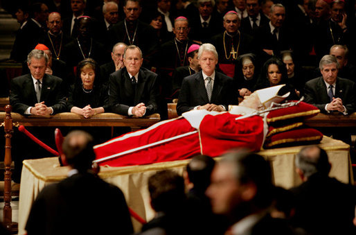 Pictured from left, President George W. Bush, Laura Bush, former President George H. W. Bush, former President Bill Clinton, Secretary of State Condoleezza Rice and White House Chief of Staff Andy Card pay their respects to Pope John Paul II as he lies in state in St. Peter's Basilica at the Vatican Wednesday, April 6, 2005. White House photo by Eric Draper
