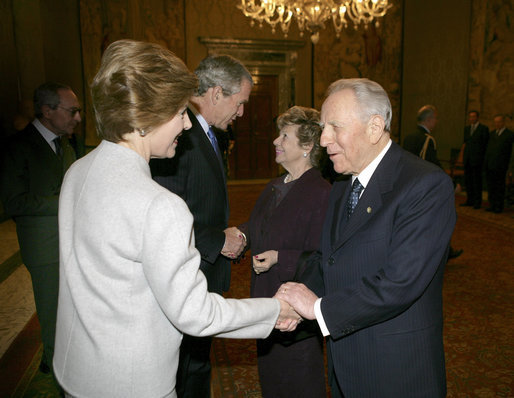 President George W. Bush and first lady Laura Bush are greeted upon their arrival to Quirinale Palace by Italy's President and first lady, Carlo and Franca Ciampi, Thursday, April 7, 2005. President and Mrs. Bush paid the courtesy visit while in Rome for the funeral of Pope John Paul II. White House photo by Eric Draper
