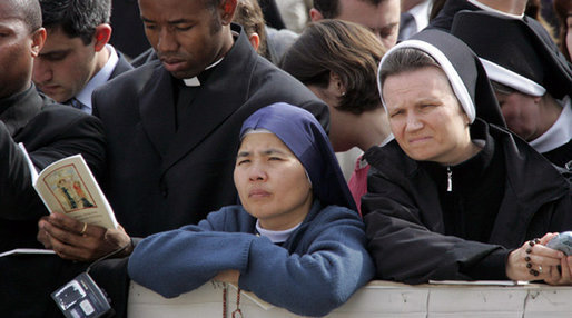 Faces of some of those in attendance Friday, April 8, 2005 inside St. Peter's Square for funeral services for Pope John Paul II.White House photo by Eric Draper