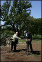 Israeli Prime Minister Ariel Sharon and President George W. Bush shake hands during a press conference at the President's Ranch in Crawford, Texas, Monday, April 11, 2005. White House photo by David Bohrer