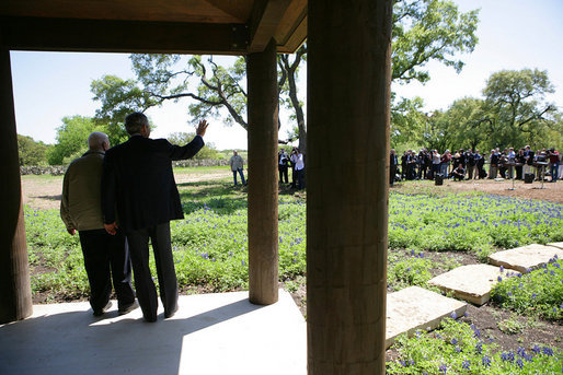 President George W. Bush and Israeli Prime Minister Ariel Sharon wave to the press while meeting at the President's Ranch in Crawford, Texas, Monday, April 11, 2005. White House photo by David Bohrer
