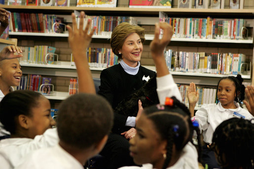 Laura Bush introduces her Scottish Terrier puppy Miss Beazley to fourth-grade students from Maury Elementary School during a visit to the Martin Luther King Jr. Memorial Library in Washington, D.C., Tuesday, April 12, 2005. White House photo by Krisanne Johnson