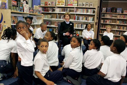 "In celebration of National Library Week, Laura Bush visits the Martin Luther King Jr. Memorial Library and talks with fourth-graders from Maury Elementary School in Washington, D.C., Tuesday, April 12, 2005. During her visit to the library, Mrs. Bush read Oliver Butterworth's ""The Enormous Egg"" and introduced her Scottish Terrier Miss. Beazley to the students. White House photo by Krisanne Johnson"