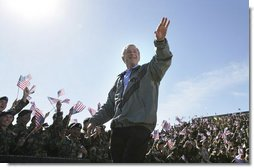 "President George W. Bush receives a rousing Fort Hood welcome Tuesday, April 12, 2005, as he arrived at the base to thank the troops for their service and sacrifice in Iraq. ""Whether you're coming or going, you are making an enormous difference for the security of our nation and for the peace of the world,"" the President said.  White House photo by Eric Draper"