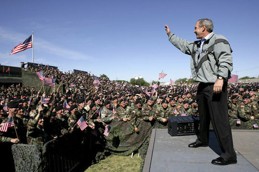 "President George W. Bush waves to the troops at Fort Hood, Texas, as he arrived Tuesday, April 12, 2005, to thank them in person for their service in Iraq. ""Americans are grateful for your sacrifice and your service,"" the President told a large portion of the 44,188 soldiers and airmen stationed at the base. "".And so is your Commander-in-Chief."" White House photo by Eric Draper"