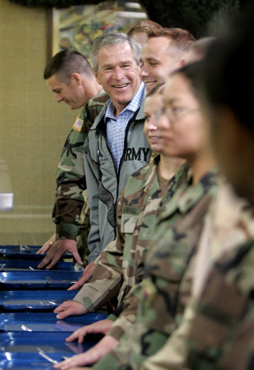 President Bush shares a meal with troops at Fort Hood, Texas Tuesday, April 12, 2005. The two divisions on base are the 1st Cavalry Division and the 4th Infantry Division. There are 44,188 soldiers and airmen stationed at the base and on an average day, there are 25,000 soldiers from Fort Hood serving outside the Continental United States. White House photo by Eric Draper