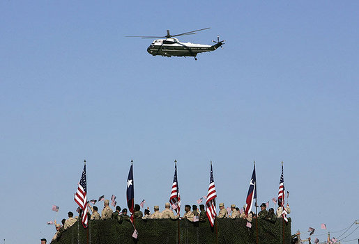 "Marine One hovers above the troops at Fort Hood, Texas, as President George W. Bush arrived Tuesday, April 12, 2005. ""It's an honor to be with the courageous men and women of the ""Phantom Corps,"" the President told the troops. White House photo by Eric Draper"
