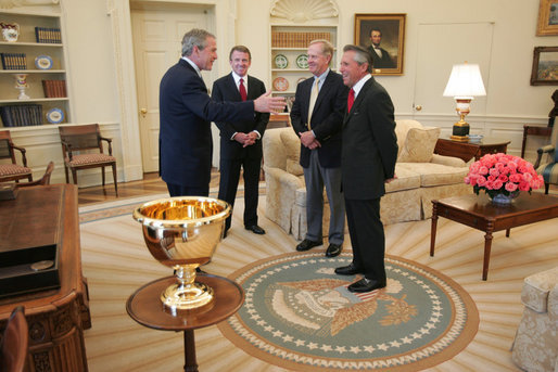As honorary chairman of the 2005 Presidents Cup, President George W. Bush shares a moment with Cup co-captains Jack Nicklaus, center, Gary Player, right, and Tim Finchem, PGA Tour director, Wednesday, April 13, 2005, in the Oval Office. The Presidents Cup, played during non-Ryder Cup years, is scheduled for September at the Robert Trent Jones Golf Club on Lake Manassas in Prince William County, Virginia. White House photo by Paul Morse
