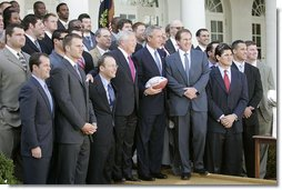 President George W. Bush poses with the New England Patriots during a ceremony honoring the 2005 Super Bowl Champions in the Rose Garden April 13, 2005.  White House photo by Eric Draper