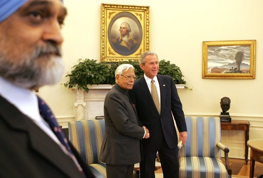 President George W. Bush greets Natwar Singh, External Affairs Minister of India, in the Oval Office of the White House, Thursday, April 14, 2005. At left is Monteq Ahluwalia, Deputy Chairman of India's Planning Commission. White House photo by Krisanne Johnson