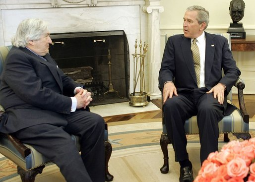 President George W. Bush meets with James Wolfensohn, the outgoing president of the World Bank Thursday, April 14, 2005, in the Oval Office of the White House. White House photo by Paul Morse
