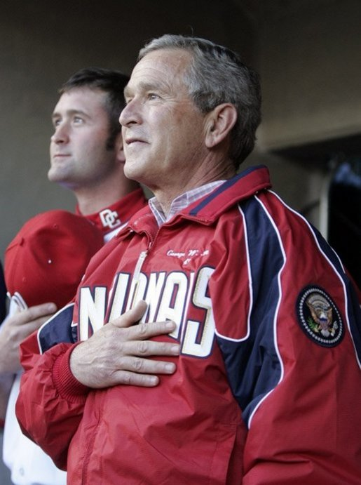 President George W. Bush during the National Anthem before throwing out the opening pitch of the Washington DC Nationals home opener at RFK Stadium in Washington DC on Thursday April 14 2005. White House photo by Paul Morse
