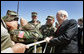 Vice President Dick Cheney poses for photos with troops during a visit to McGuire in New Jersey Friday, April 15, 2005. White House photo by David Bohrer