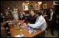 President George W. Bush talks with patrons at a coffee shop in Mentor, Ohio, April 15, 2005. White House photo by Paul Morse