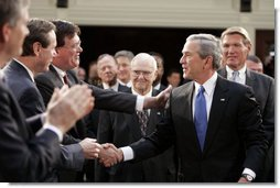 President George W. Bush greets South Carolina legislators upon his arrival to the State House in the state capitol Monday, April 18, 2005. White House photo by Paul Morse