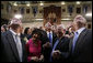 President George W. Bush wades into a crowd of legislators at the State House in Columbia, S.C., Monday, April 18, 2005. White House photo by Paul Morse