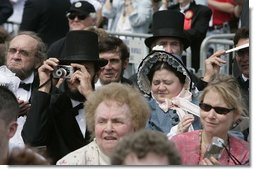 One of the many Lincoln look-alikes attending the dedication of the Abraham Lincoln Presidential Library and Museum captures a few memories for himself in Springfield, Ill., Tuesday, April 19, 2005.  White House photo by Eric Draper