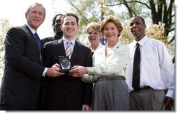 President and Mrs. Bush stand with Jason Kamras, the 2005 National Teacher of the Year, after he was honored during ceremonies in the Rose Garden Wednesday, April 20, 2005. Joining them are Secretary of Education Margaret Spellings and former students Wendall Jefferson, left, and Marco Jeter.  White House photo by Eric Draper
