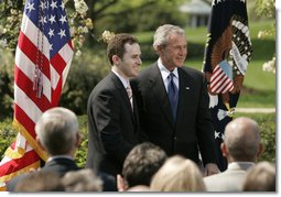 President George W. Bush and Jason Kamras, 2005 National Teacher of the Year, stand for photos in the Rose Garden Wednesday, April 20, 2005, after Mr. Kamras, a 7th and 8th grade math teacher at John Philip Sousa Middle School in Washington, D.C., was honored for his work. White House photo by Krisanne Johnson