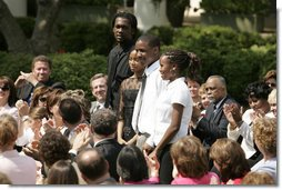 From left: Wendall Jefferson, Ta-Sha Watkins, Marco Jeter and Brandy Beaman receive applause as they stand after being acknowledged by their math teacher, Jason Kamras, the 2005 National Teacher of the Year, during ceremonies at the Rose Garden. White House photo by Krisanne Johnson