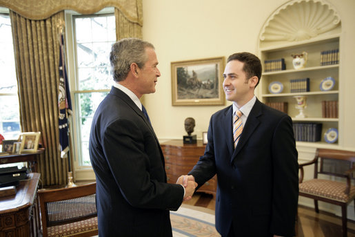 "President George W. Bush welcomes Jason Kamras, the 2005 National Teacher of the Year, to the Oval Office during ceremonies Wednesday, April 20, 2005, at the White House. Mr. Kamras, a 1996 Princeton graduate, teaches seventh and eighth grade math at John Philip Sousa Middle School in Washington, D.C. ""Teaching is a commitment to equity and opportunity for all children,"" says Mr. Kamras, who took time away from teaching in 1999-2000 to earn his Master's degree at Harvard. ""It is a promise of a better future for those who have been left behind."" White House photo by Eric Draper"
