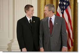 President George W. Bush congratulates Scott Elder, 15, of Chino Hills High School in Chino Hills, Calif., on receiving the President's Environmental Youth Award in the East Room of the White House April 21, 2005.  White House photo by Paul Morse