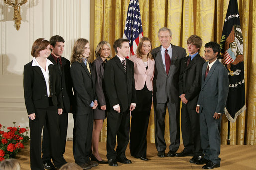 President George W. Bush congratulates members of the Cairo High School Science Club and Biology Students' Environmental Issues Outreach Program in Cairo, Ga., on receiving the President's Environmental Youth Award in the East Room of the White House April 21, 2005. Members of this club include, from left, Anna Dorsey, 16, Luke Walden, 16, Brian Dekle, 19, Jessica Brock, 19, John Palmer, 16, Keri Cassels, 16, Brandon Phillips, 19, and Vikram Jambulapati, 18. White House photo by Paul Morse