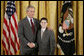 President George W. Bush congratulates James Quadrino, Jr., 13, of the Elias Bernstein School on Staten Island, N.Y., on receiving the President's Environmental Youth Award in the East Room of the White House April 21, 2005. White House photo by Paul Morse